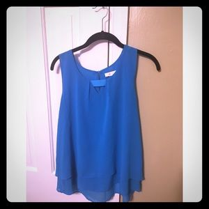 Bright blue top with tiny cut out and detailing